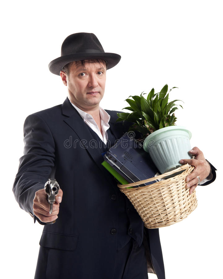 Businessman with gun hold personal belongings. Businessman in suit and hat with gun hold basket with personal belongings on white background royalty free stock photography