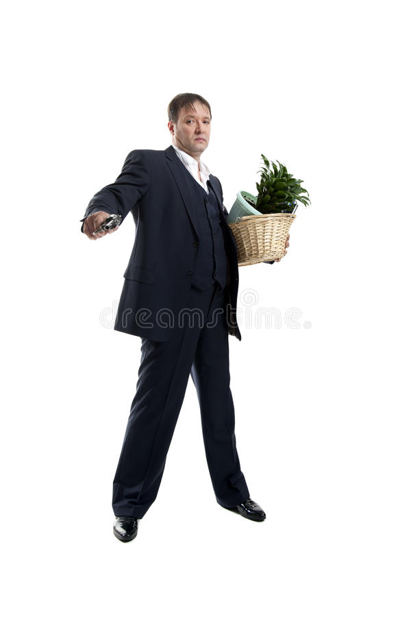 Businessman with gun hold personal belongings. Businessman in suit and hat with gun hold basket with personal belongings on white background royalty free stock photos