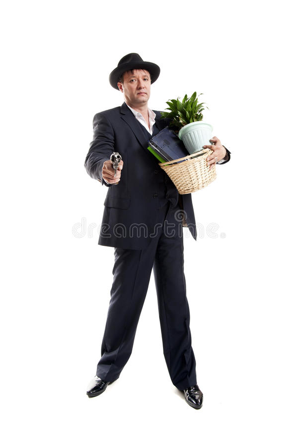 Businessman with gun hold personal belongings. Businessman in suit and hat with gun hold basket with personal belongings on white background stock images