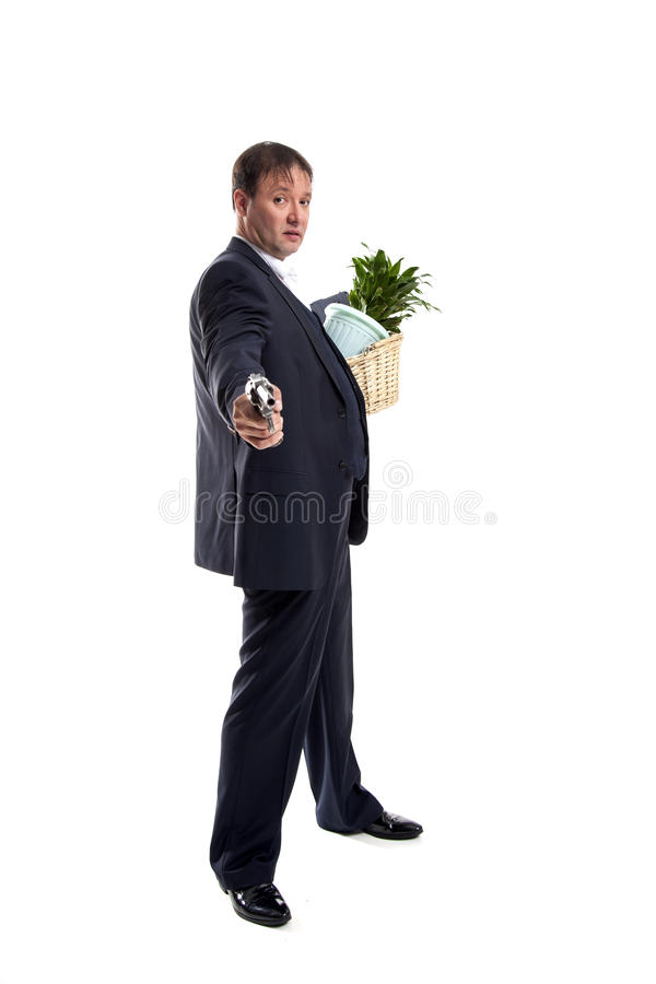Businessman with gun hold personal belongings. Businessman in suit and hat with gun hold basket with personal belongings on white background stock photo