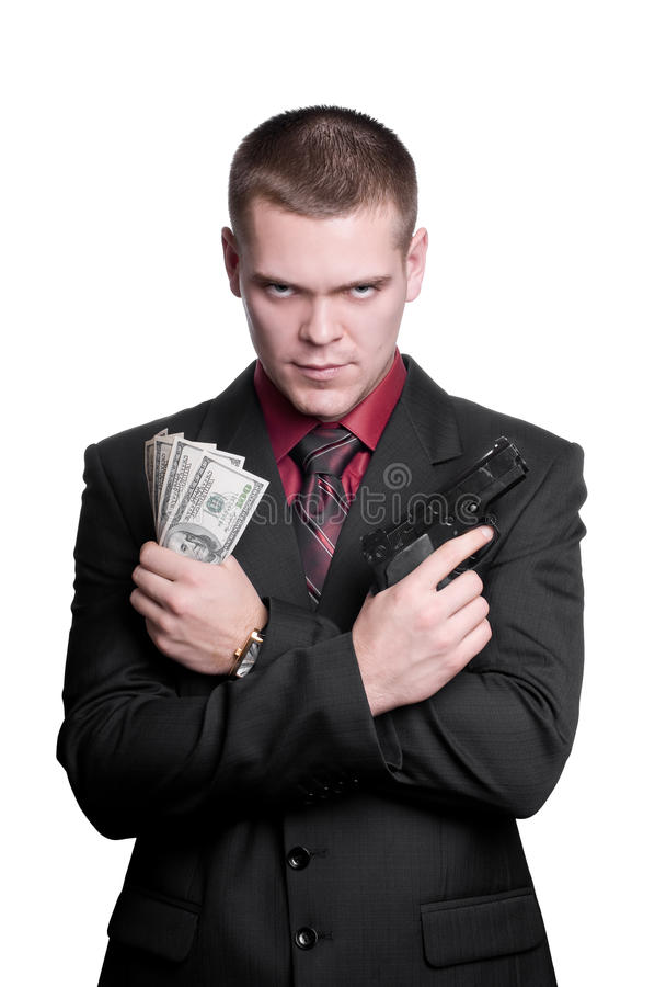 Businessman with gun and money stock photography