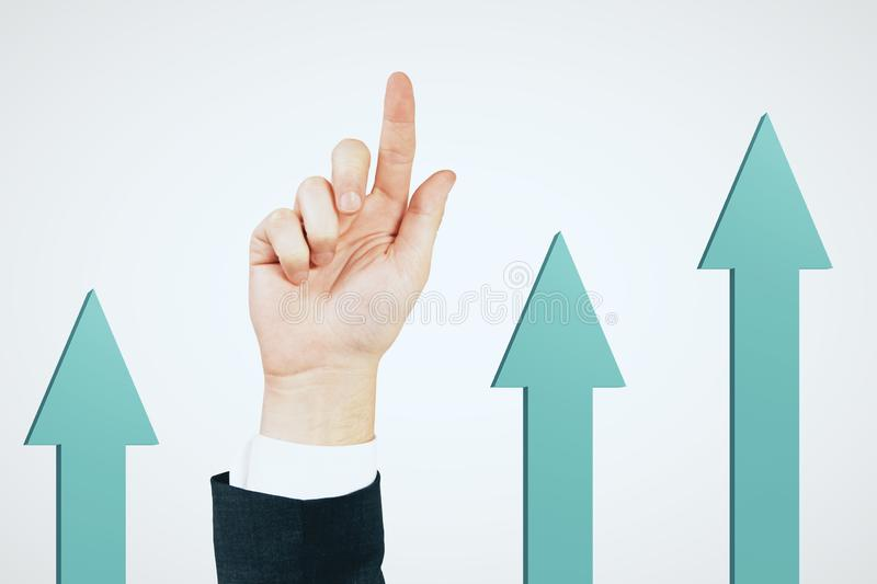 Success and financial growth concept. Businessman hand and blue arrows pointing up on white background. Success and financial growth concept royalty free stock photo