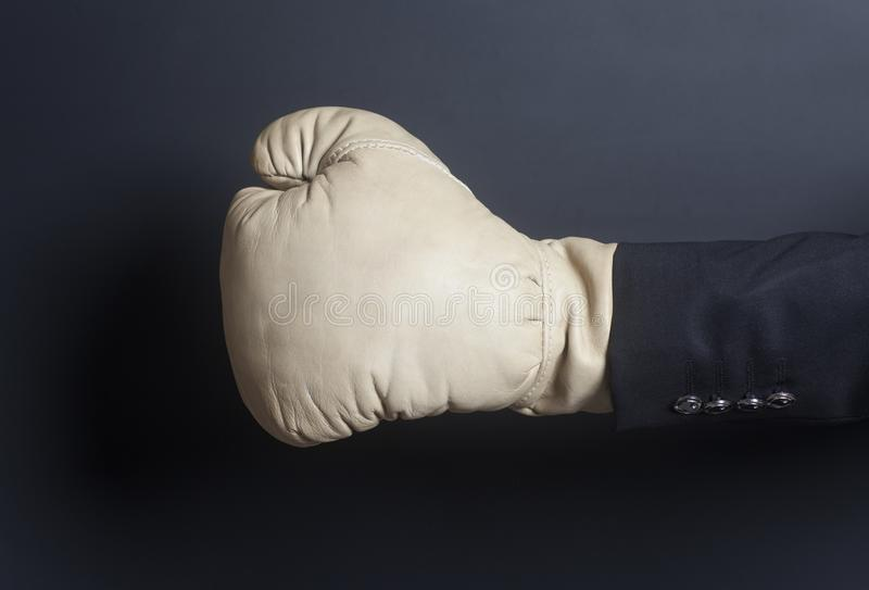 Businessman hand in Boxing glove royalty free stock photo