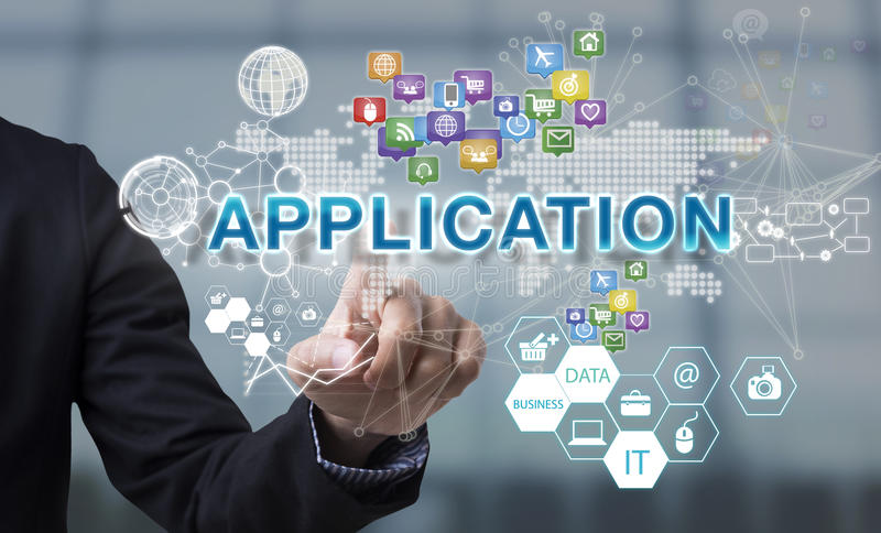 Businessman hand chooses Application wording on interface screen royalty free stock photo