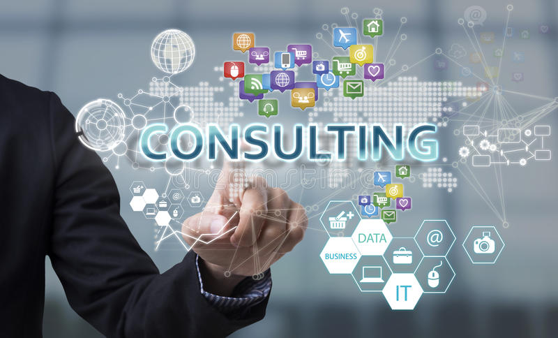 Businessman hand chooses Consulting wording on interface screen. royalty free stock photography