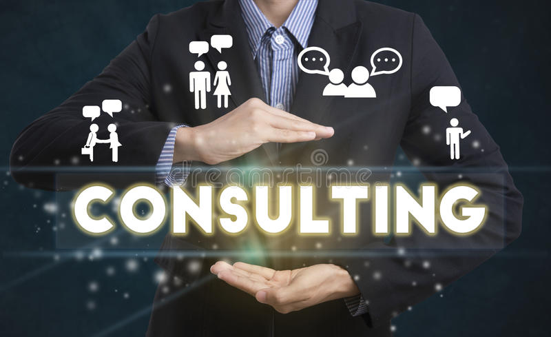 Businessman hand chooses Consulting wording on interface screen. stock image