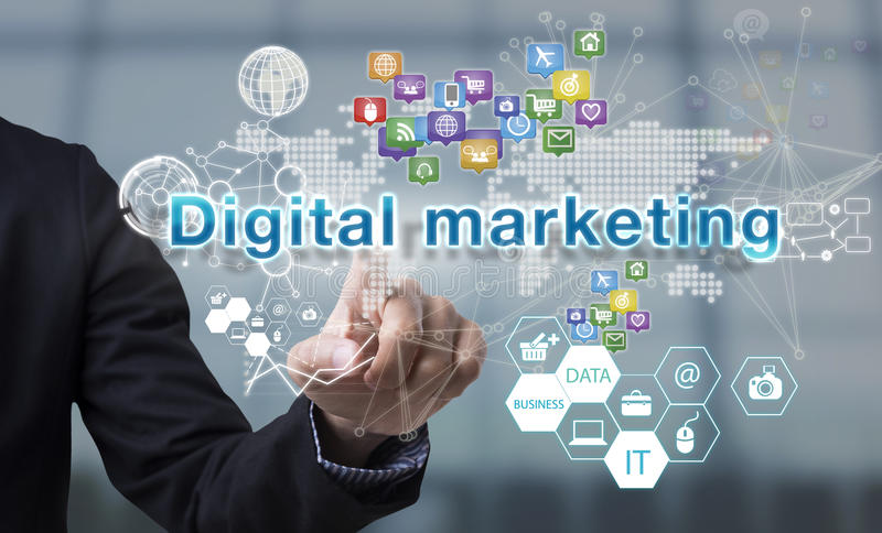 Businessman hand chooses Digital marketing wording on interface. Screen. internet technology service concept. can used for cover page presentation and web royalty free stock photo