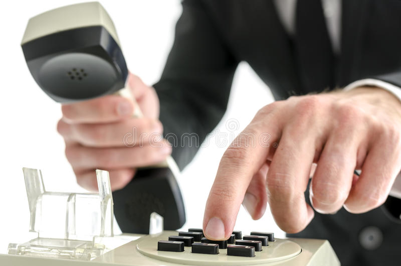 Businessman hand dialing a phone number royalty free stock images