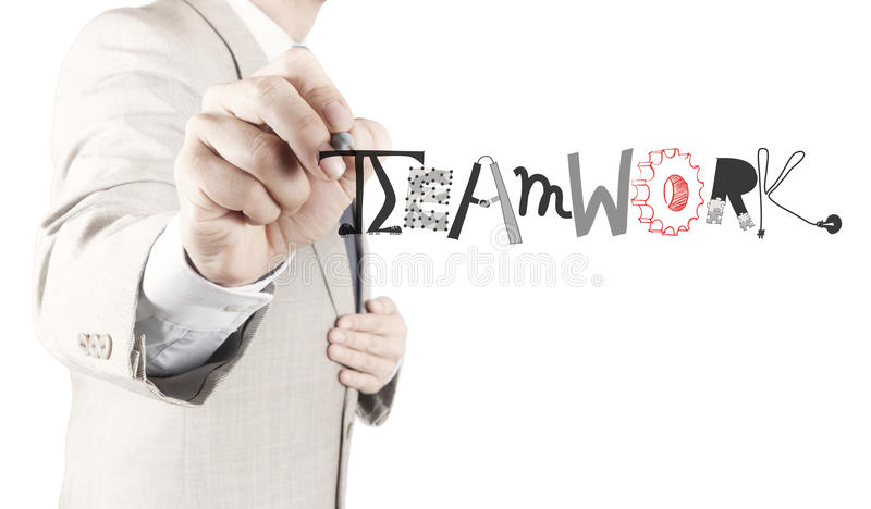 Businessman hand drawing design graphic word. TEAMWORK as concept royalty free stock images