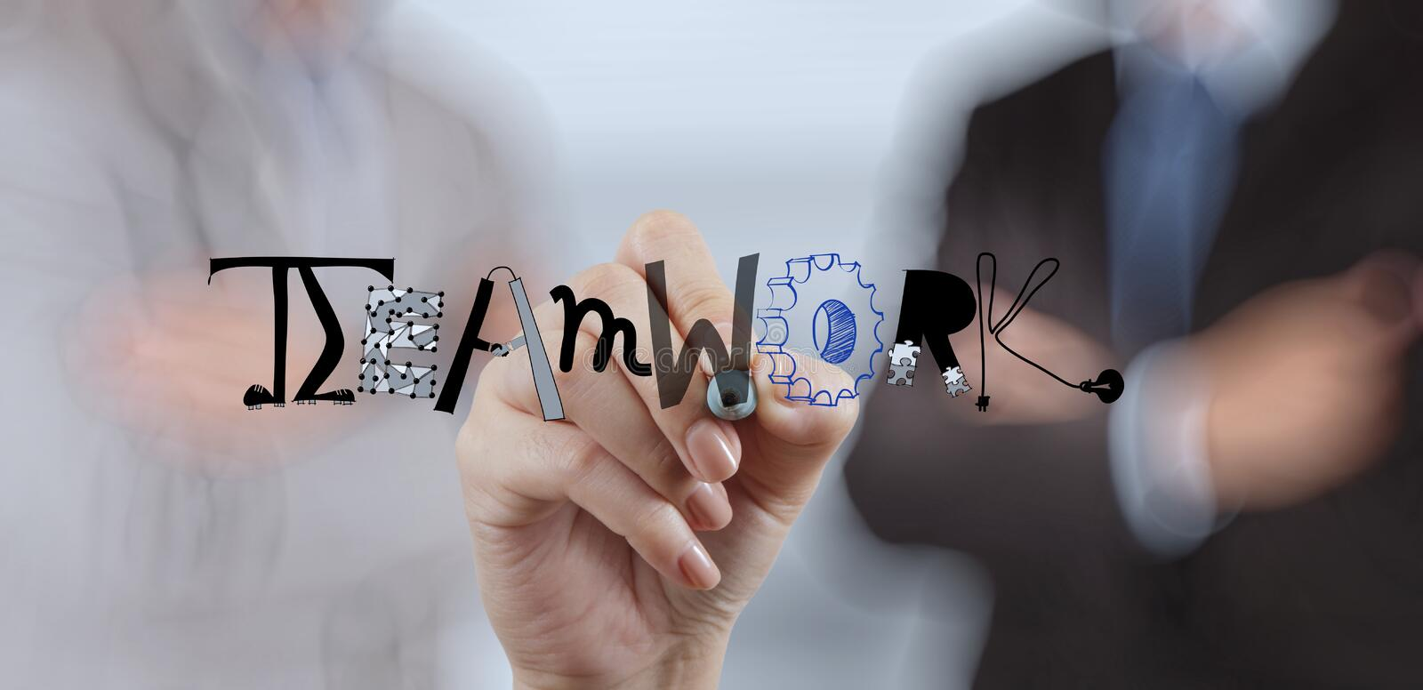 Businessman hand drawing design graphic word TEAMWORK stock image