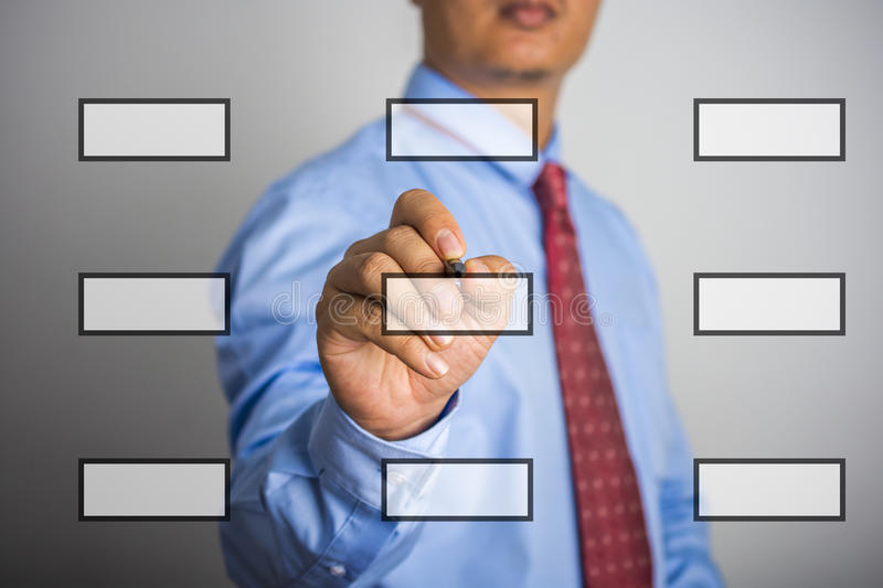 Businessman hand drawing flowchart in a whiteboard.  stock photo