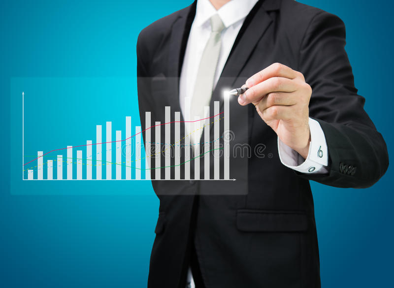 Businessman hand drawing a graph Isolated. On blue background royalty free stock photos