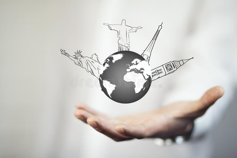 Businessman hand draws the airplane travel around the world stock image