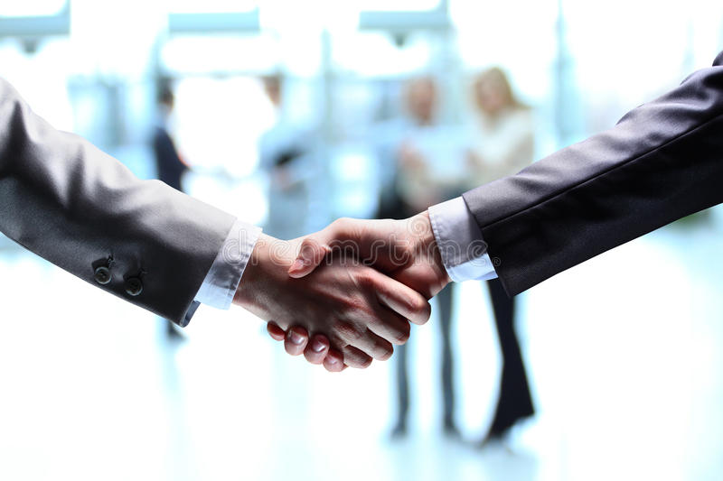 The businessman. Hand for a handshake. The conclusion of the transaction royalty free stock image