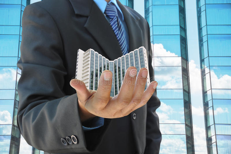 Businessman hand hold building royalty free stock photo