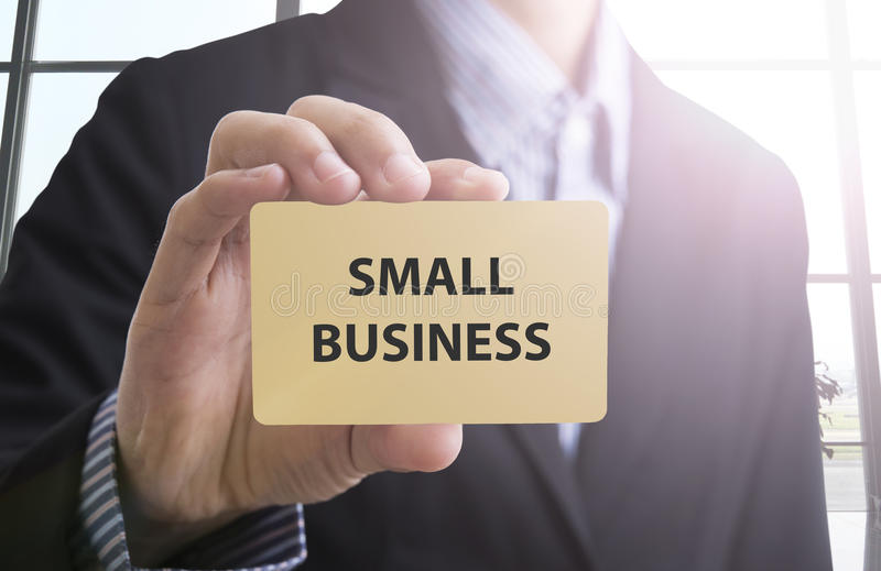 businessman hand holding a business card with a message small bu royalty free stock photos