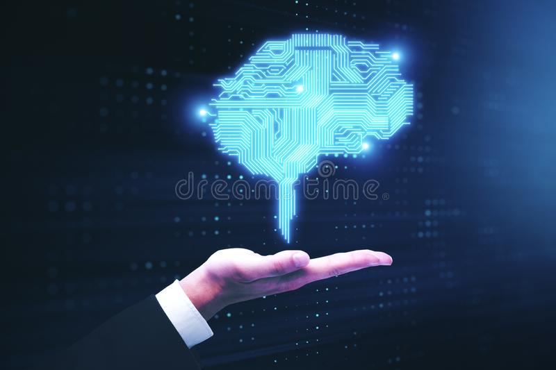 Businessman hand holding circuit brain. Businessman hand holding glowing digital circuit brain. Artificial intelligence and technology concept stock photos