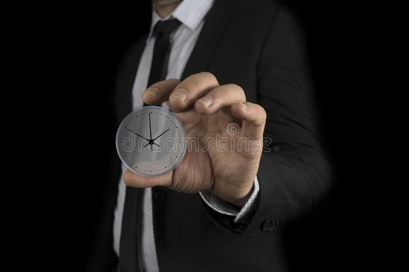 Businessman hand holding clock in the screen royalty free stock photo