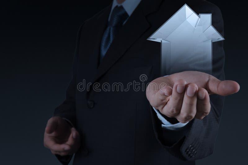 Businessman hand holding 3d house as insurance stock photos
