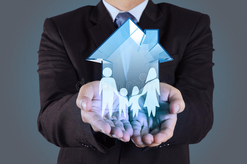 Businessman hand holding 3d house royalty free stock photos