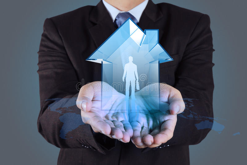 Businessman hand holding 3d house royalty free stock image