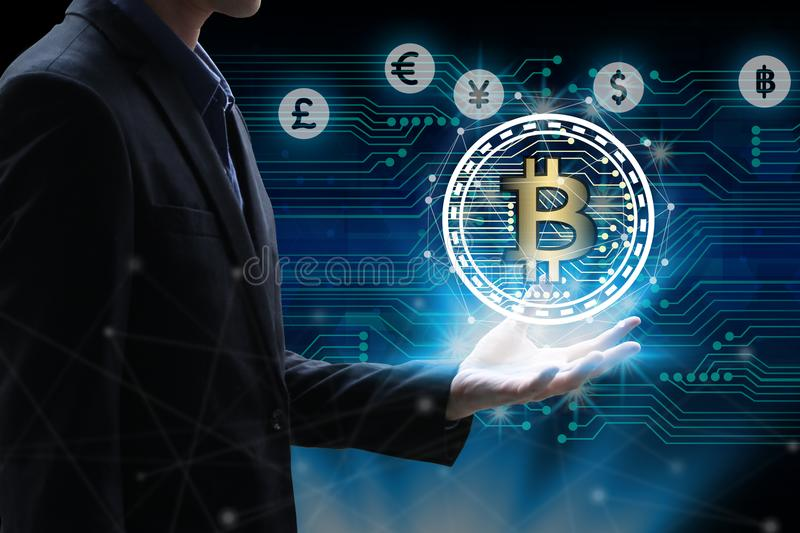 Businessman hand holding global network using Currencies sign symbol interface of Bitcoin Fintech, virtual currency blockchain te. Chnology concept, Investment royalty free stock image