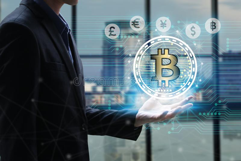 Businessman hand holding global network using Currencies sign symbol interface of Bitcoin Fintech, virtual currency blockchain te. Chnology concept, Investment royalty free stock photography
