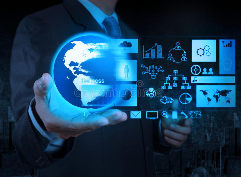 Businessman hand holding globe with business diagram stock photo