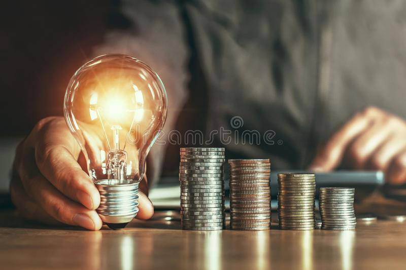 businessman hand holding light bulb. idea concept with innovation stock photography