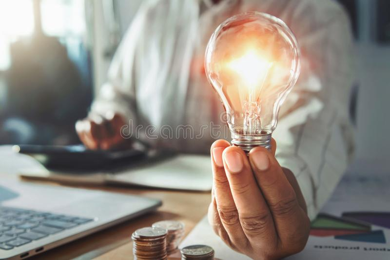 Businessman hand holding light bulb. idea concept with innovation and inspiration. Account, accounting, background, bright, creative, creativity, design royalty free stock images