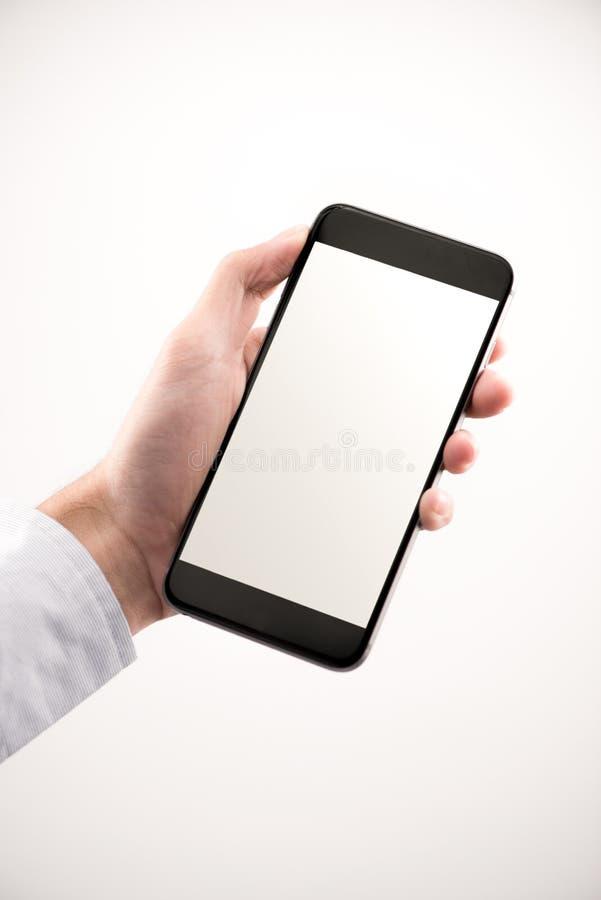 Businessman Hand holding mobile smart phone with blank screen, i. Businessman Hand holding mobile smart phone with blank screen, on white royalty free stock photos