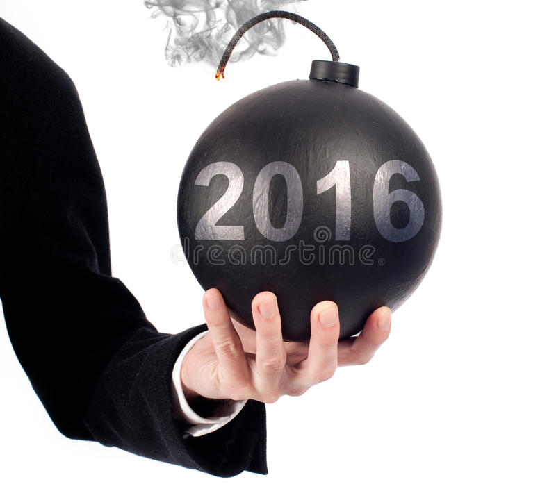 Businessman hand holding an old-fashioned bomb stock images