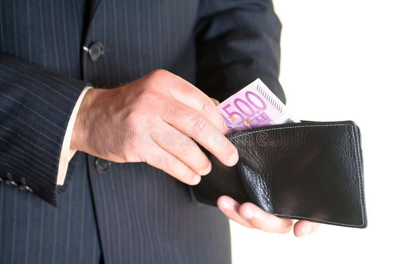 Businessman hand holding a opened wallet stock image