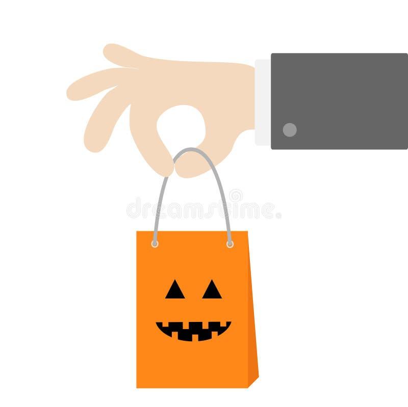 Businessman hand holding shopping paper bag handle. Pumpkin smile face emotion. Present inside. Special offer. Happy Halloween sig stock illustration