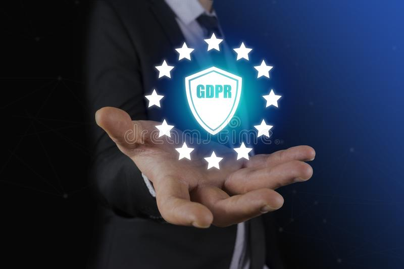 Businessman hand holding sign general data protection regulation GDPR and shield with GDPR inscription stock photos