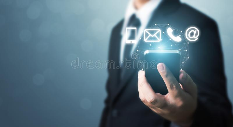 Businessman hand holding smart phone with icon mobile phone, mai stock images