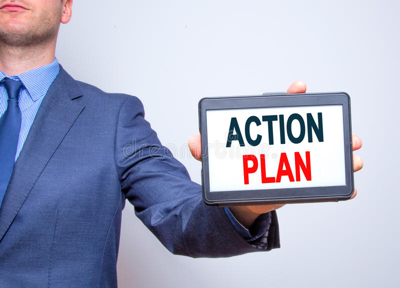 Businessman hand holding tablet with Action Plan text sign. Isolated on white. Business concept. Stock photo royalty free stock photo