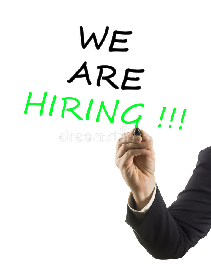Businessman hand with marker writing text we are hiring stock photography