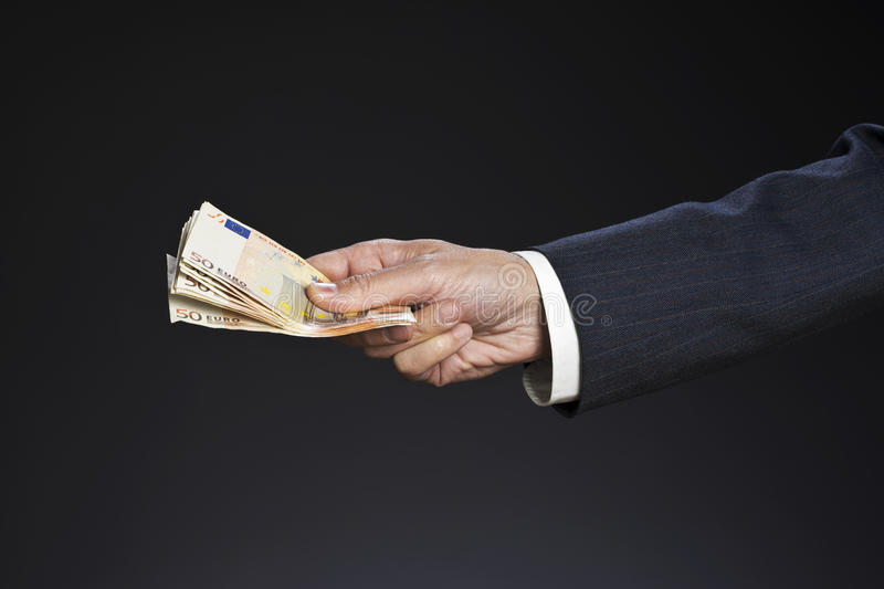 Businessman hand and money stock image