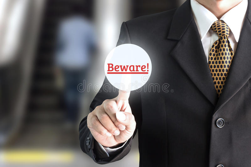 Businessman hand pointing on the screen keypad careful. Can be used for editing text or image of your fingers royalty free stock photography