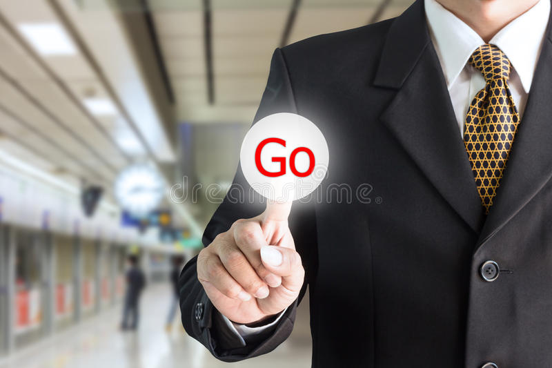 Businessman hand pointing to on-screen keyboard with word go. Can be used for text editing or bring your commercials royalty free stock photos