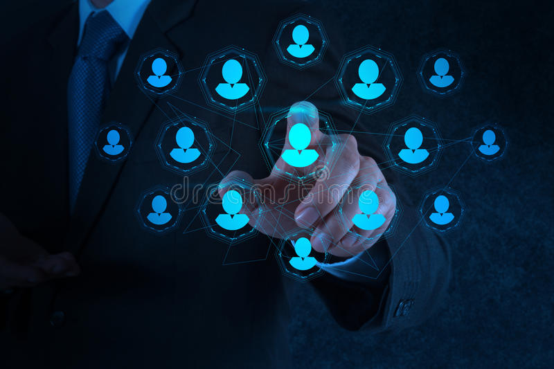 Businessman hand points human resources, CRM and social media stock photos