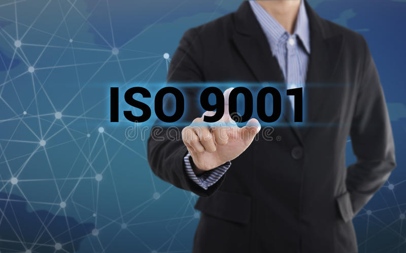 Businessman hand pressing button ISO 9001. royalty free stock photo