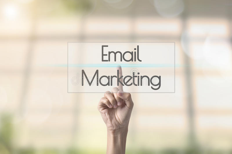 Businessman hand pressing wording Email marketing. stock photo