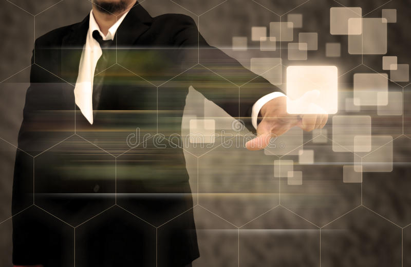 Businessman hand pushing button on a touch screen interface royalty free stock photography