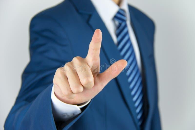 Businessman hand pushing screen stock photography