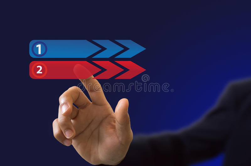 Businessman hand pushing on a touch button interface on blue bac royalty free stock images