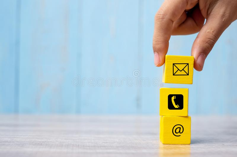 Businessman hand putting wooden block cube symbol email, telephone and address website.  contact, marketing and information. Concept royalty free stock photos
