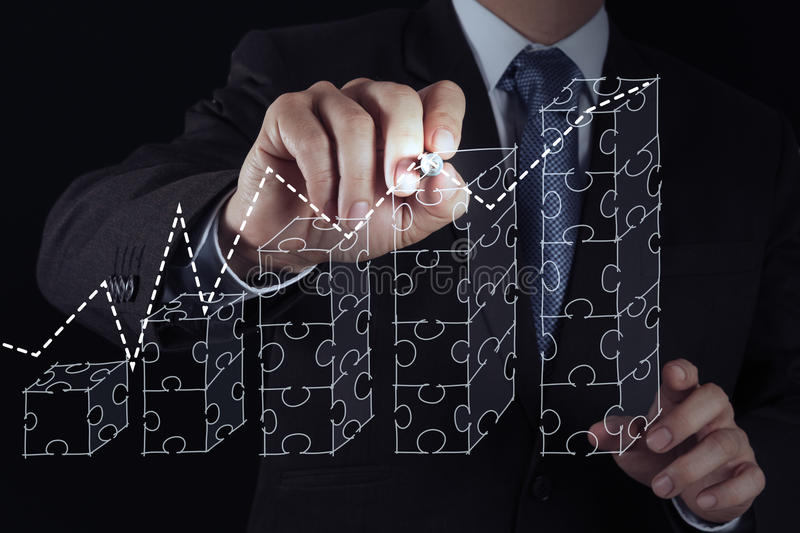 Businessman hand puzzle charts stock photography