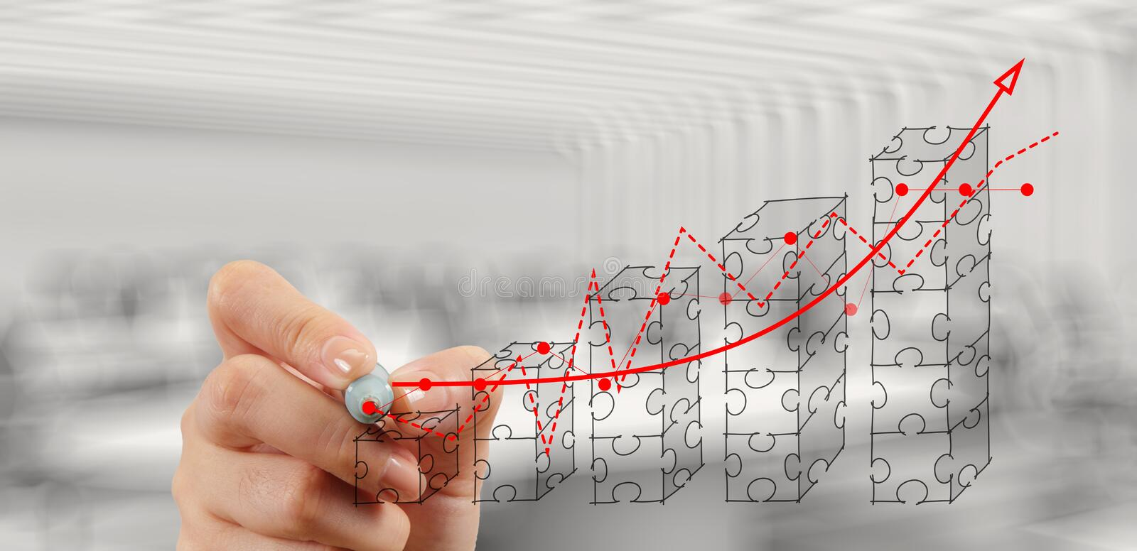 Businessman hand puzzle charts with new modern computer royalty free stock photography